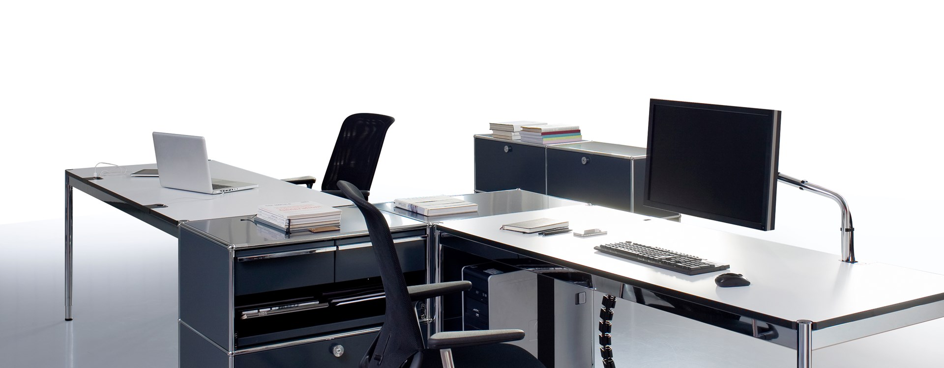 full suite of USM Haller commercial furniture with gray storage pieces and customized desks