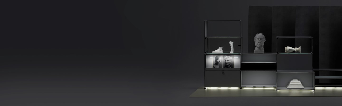 black USM Haller E furniture with different lighting temperatures