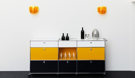 black, yellow and white USM Haller dining room storage in a 60s style home