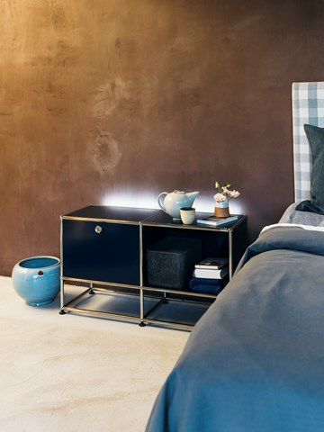 graphite black bedside table in an industrial bedroom