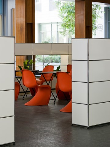 white USM haller furniture creating walls and doorway in open plan office