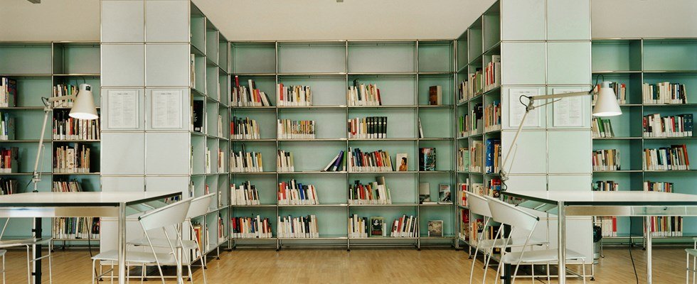 USM Haller grey bookshelves in library