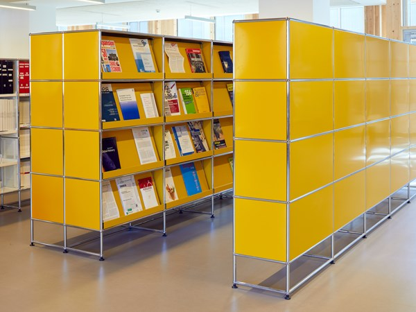 Row of USM Haller yellow bookcases