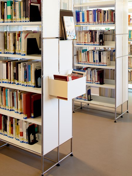 USM Haller white bookshelves