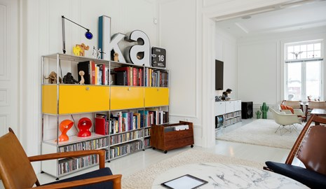 yellow USM Haller bookcase with CD storage