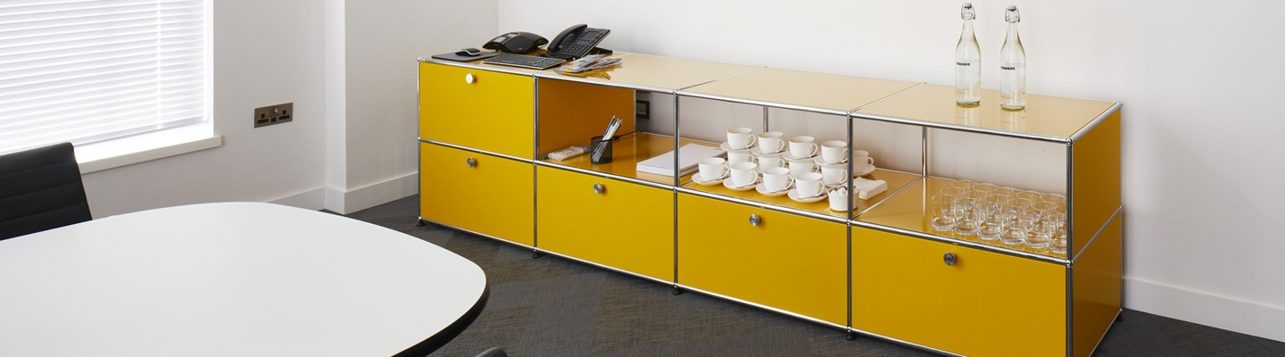 golden yellow USM haller sideboard in modern meeting room
