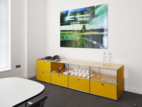 golden yellow USM haller sideboard in modern office meeting room