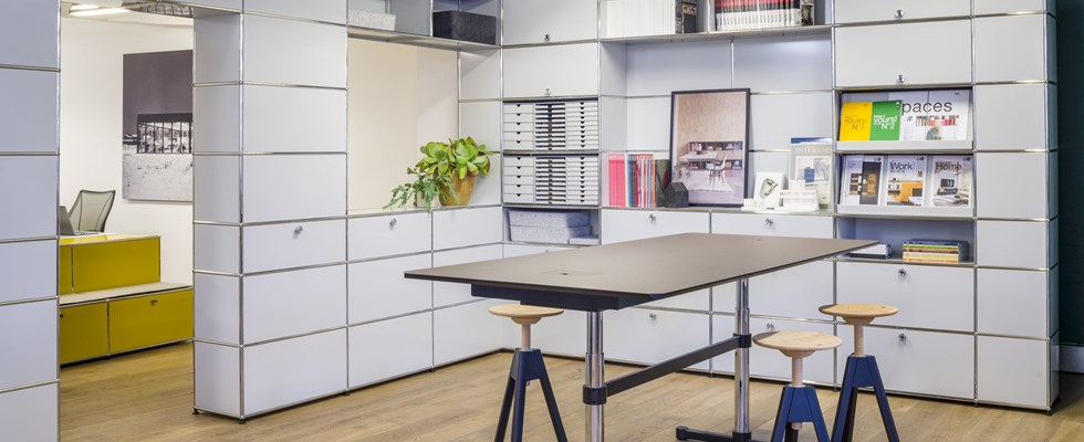 modern open plan office with white modular furniture and desks