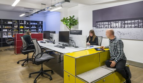 yellow USM Haller end of desk storage with seating for agile working