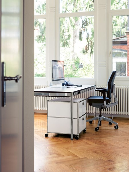 white USM Haller two drawer pedestal in private office