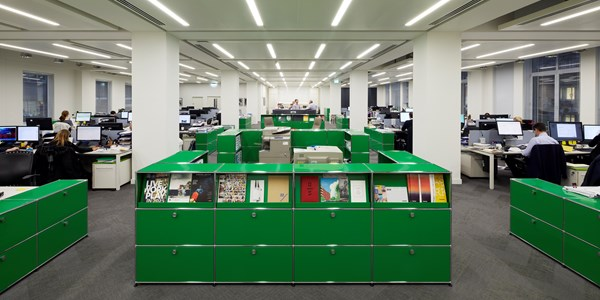 green USM Haller room divider with magazine shelves, storage and filing